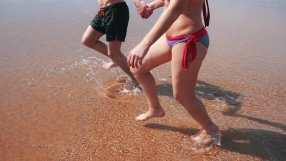 Thumbnail for Happy Couple Running On Beach