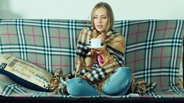 Cover Image for Attractive Woman Sitting On The Couch: It Is Very