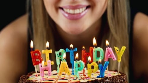 Girl Blows Out The Candles On The Cake, Smiles