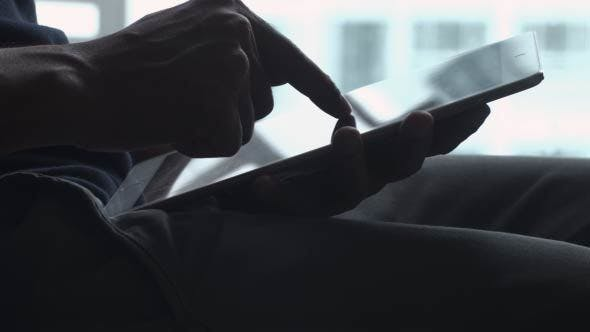 Cover Image for Men Using Tablet