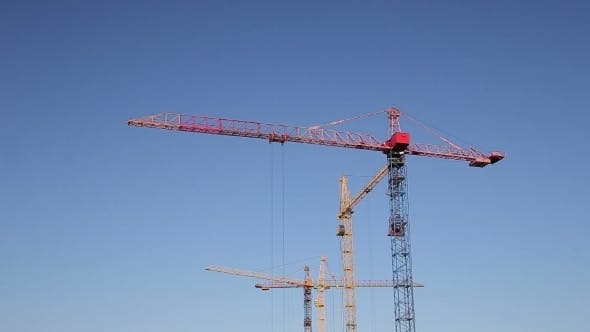 Thumbnail for Cranes Working On Construction Site Under Clear