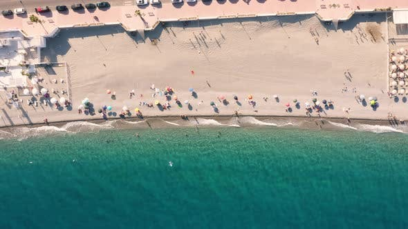 Vertical View of Beach Umbrellas by the Sea in Summer