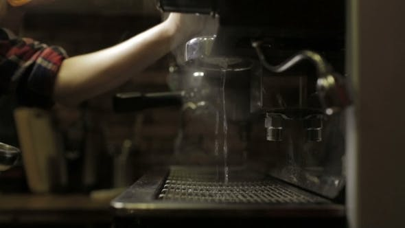Thumbnail for Barista Prepares Coffee Machine For Cappuccino