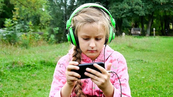Cover Image for Girl Listening To Music From a Smart Phone
