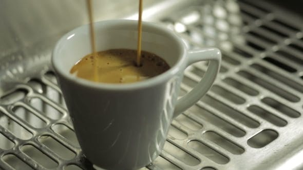 Thumbnail for Coffee Machine Pouring Coffee In Small Cup