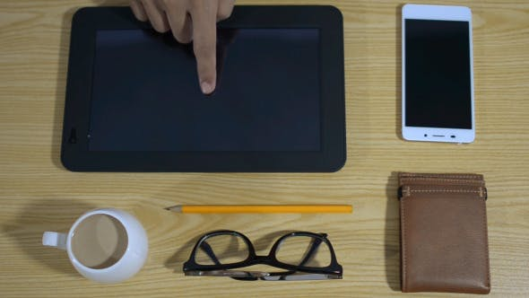 Cover Image for Freelancer Working on Tablet Online