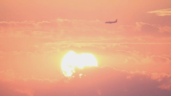 Thumbnail for Plane At Sunset