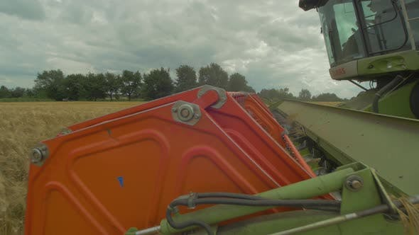 Thumbnail for Rotor of combine harvester cutting wheat ears