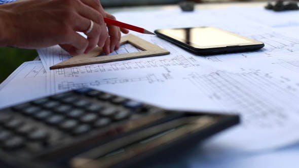 Employee Make Calculations on a Calculator