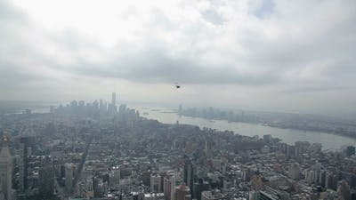 Helicopter Flying Over The Empire State Building
