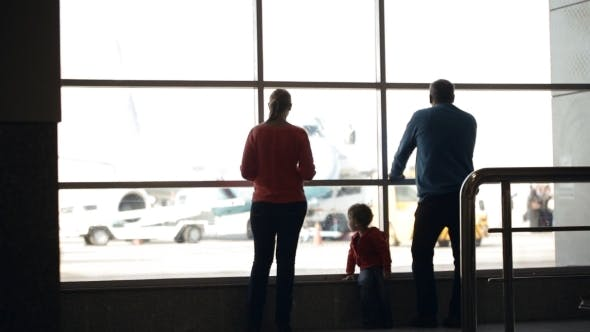 Thumbnail for Young Family Watching Planes At An Airport