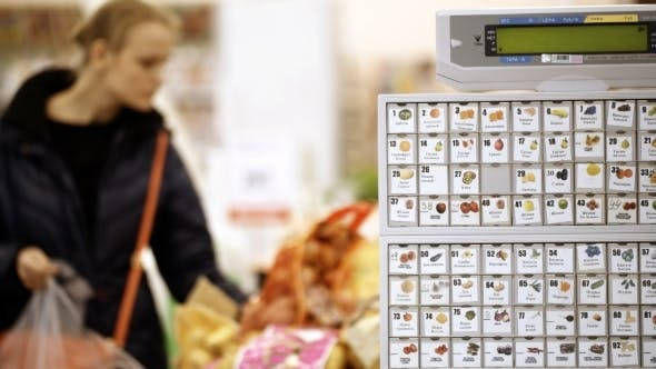 Thumbnail for Young Woman Shopping In Supermarket And Choosing