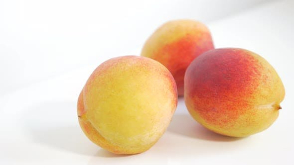 Thumbnail for Peaches tasty  fruit UHD 4k footage panning  on white background - Juicy peach on white background 3