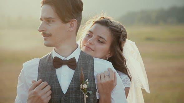 Bride Hugs Bridegroom. Fiance With Mustaches