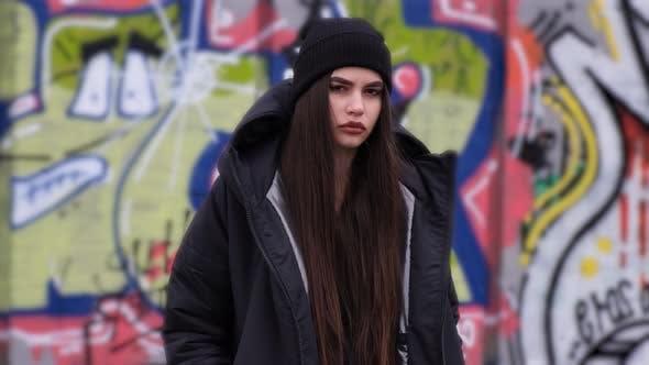 Cover Image for Portrait of Trendy Pretty Brunette Girl Posing Outdoors. Female Model Wearing Stylish Long Black
