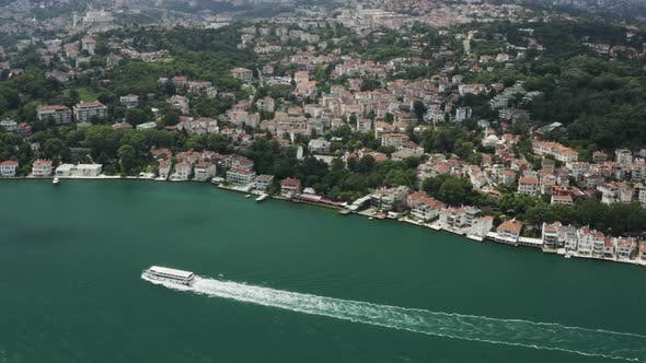 Thumbnail for Istanbul Bosphorus Waterside House And Boat Passing Aerial View
