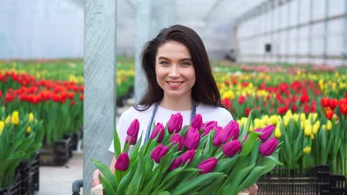 Portrait of a Young Woman Employee Greenhouses