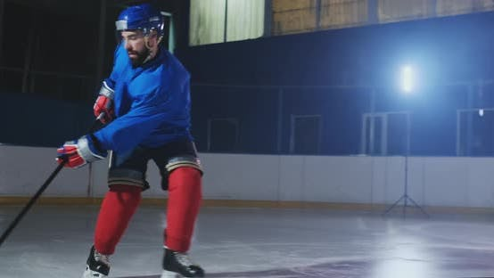 Cover Image for Hockey Forward Carrying a Puck, Skating Past an Opposing Defenseman and Taking a Slap Shot