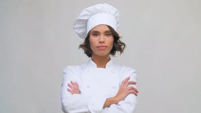 Smiling Female Chef in Toque