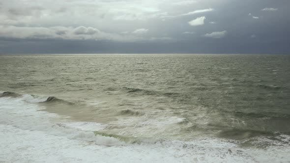 Cover Image for Gray Sky with White Clouds and Post-storm Sea