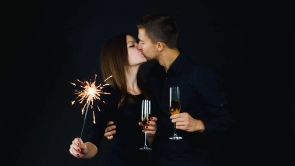 Thumbnail for Young Couple With Glasses Of Champagne And a