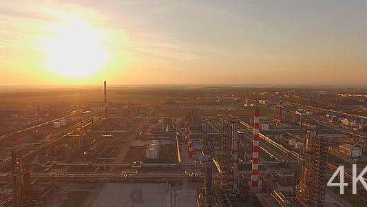 Thumbnail for Huge industrial plant with pipes at sunset