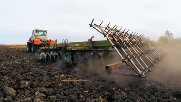 Thumbnail for Rural Tractor Trailer Cultivating Soil Of