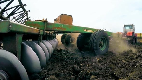 Thumbnail for Trailer Of Tractor Plowing Soil In The Field
