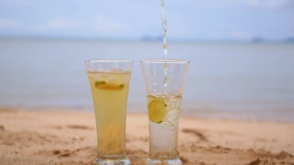 Thumbnail for Pouring Refreshing Soft Drink In Sand On Beach