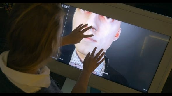 Thumbnail for Womam Looking At 3D Human Model On Touchscreen