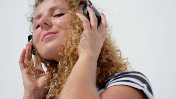 Thumbnail for Young Female Relaxing In Headphones Listening