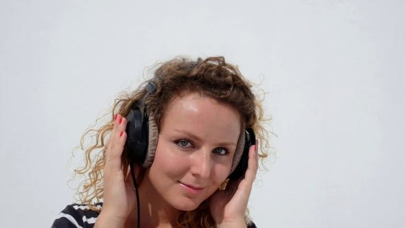 Thumbnail for Happy Woman With Headphones Listening To Music