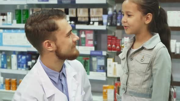 Thumbnail for Good Pharmacist Gives a Little Girl Medicine