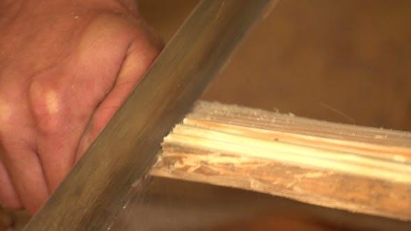 Thumbnail for Carpenter Cleans Wood Plane