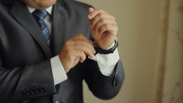 Thumbnail for Businessman Putting On A Watch