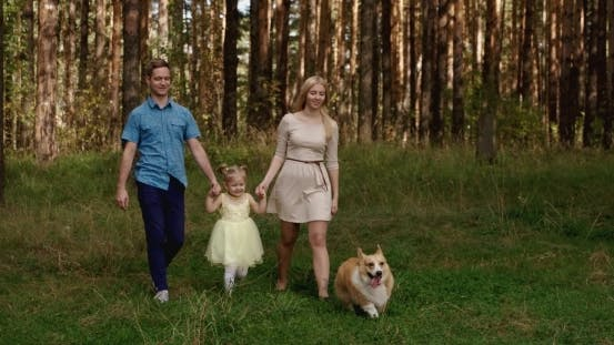 Thumbnail for Young Family Outdoors Walking Through Park