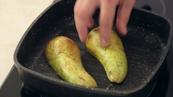 Thumbnail for Chef Is Putting Freshly Cut Pear On a Frying Pan