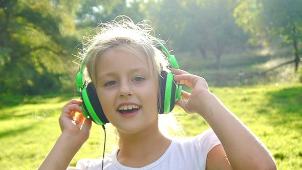 Thumbnail for Girl Listens to Music on a Sunny Day