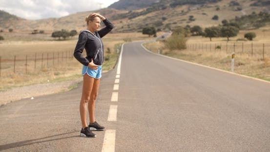 Thumbnail for Sporty Woman Standing Alone On The Road