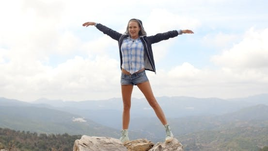 Thumbnail for Sporty Woman Standing On Top Of Rock