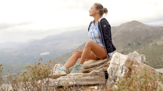 Thumbnail for Fit Woman Resting At Rock