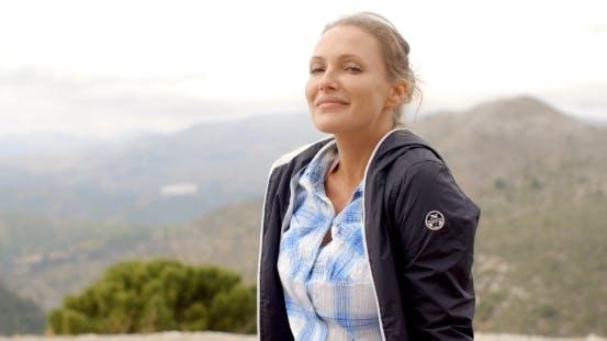 Thumbnail for Portrait Of Blond Woman, She Enjoys Mountain