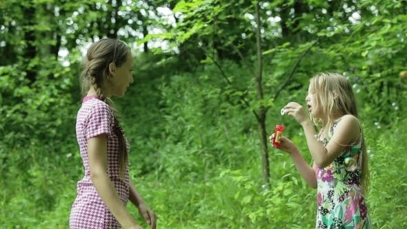 Thumbnail for Young Girls Blowing Soap Bubbles Outdoor