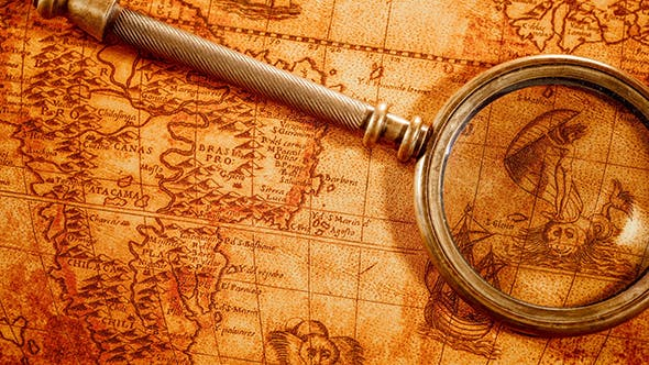 Thumbnail for Vintage Magnifying Glass Lies On Ancient World Map