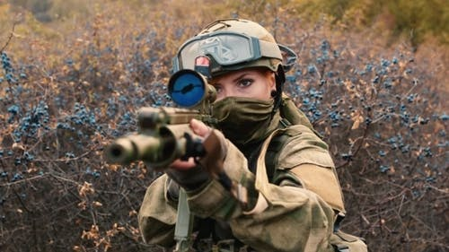 A Woman Soldier With a Weapon