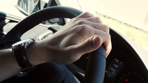 Thumbnail for Hand On Steering Wheel In a Modern Car