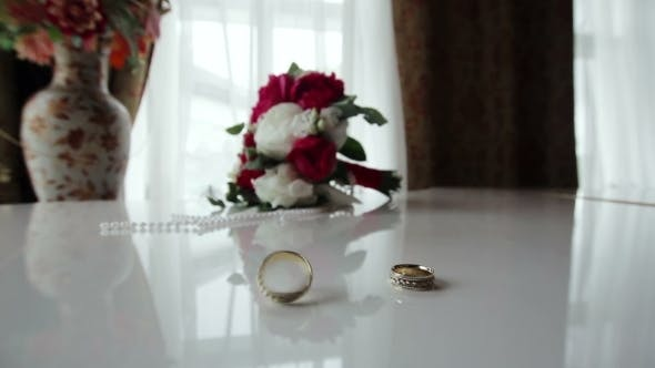 Thumbnail for Rotating Wedding Rings Near Bouquet On The Piano