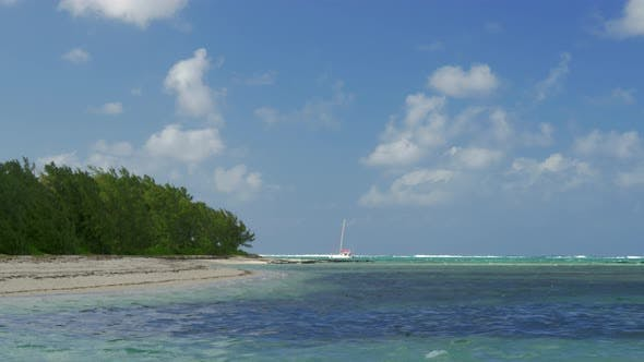 Thumbnail for Picturesque View of Strand and Indian Ocean and Sailing Yacht, Mauritius Island