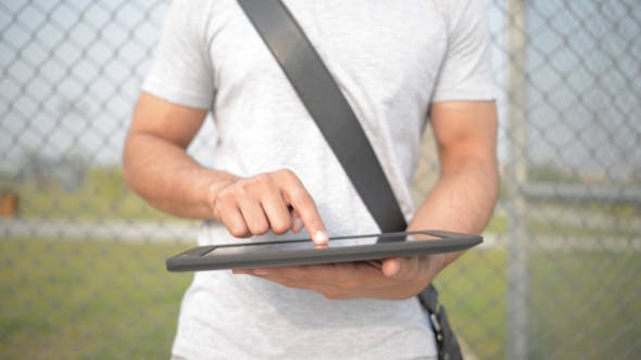 Thumbnail for Casual Man Using Tablet in Open Air