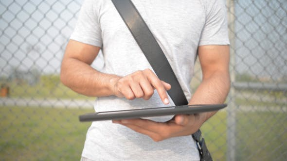 Cover Image for Casual Man Typing Text Message Tablet in Open Air